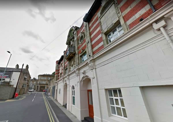 A Google StreetView Image showing what remains of the former Empire Cinema, Accrington, and beyond it the site of the former Prince's Theatre - Click to Interact.