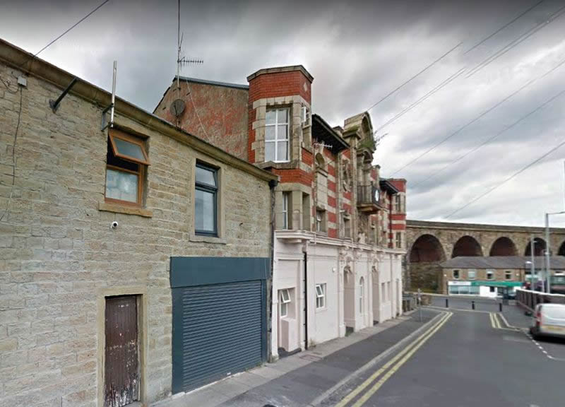 A Google StreetView Image showing the site of the former Prince's Theatre, Accrington, and next door what remains of the former Empire Cinema - Click to Interact.