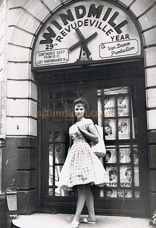 Jill Millard, poses outside the Windmill Theatre in 1960
