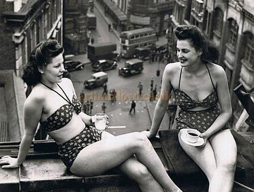 Two of the Windmill Girls, Vicki Emra and Beryl Catlin, take a break on the roof of the Windmill Theatre - Courtesy Jill Millard Shapiro.