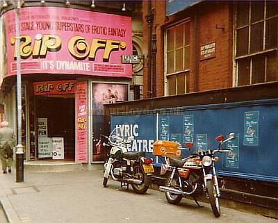 Windmill Theatre June 1977 - Photo M.L. NB. The CZ Motorcycle parked by The Lyric Theatre hoardings belonged to the late Sir Ralph Richardson who was also an avid BMW Motorcycle owner, he was appearing at the Lyric at the time, in 'The Kingfisher'.