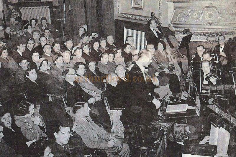 An audience and the orchestra of the Grand Theatre, Derby in the 1950s - Courtesy John West