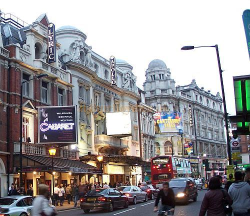 Shaftesbury Avenue showing four of London's West End Theatres in a row, the Lyric Theatre, the Apollo Theatre, the Gielgud Theatre, and the Queen's Theatre in October 2006 - Photo M.L.