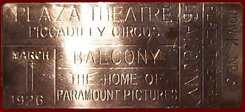 One of the Brass Tickets issued for the opening performance at the Plaza Theatre, Piccadilly Circus, on March the 1st 1926 - Kindly donated by Kenneth Parton.