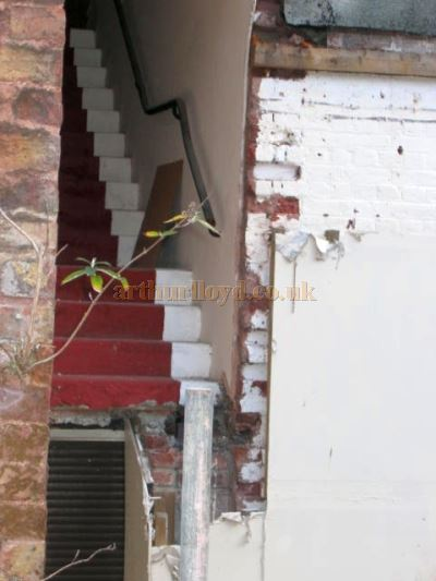 A staircase to nowhere at the rear of the Theatre Royal, Portsmouth after the loss of the Stage House - Courtesy Peter Foulstone.