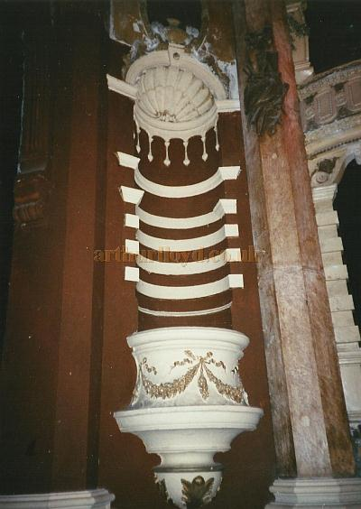 A detail of the auditorium of the Theatre Royal, Portsmouth in a photograph by David Garratt taken shortly before the renovation of the Theatre in the early 2000s.