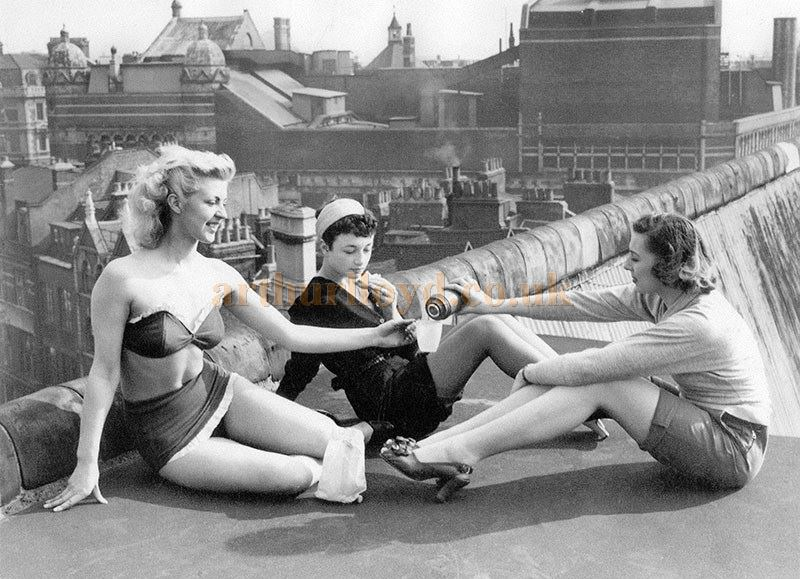 Pamela Green and fellow showgirls from Robert Nesbitt's Latin Quarter on the roof of the London Casino in 1951. Greek Street and Old Compton Street can be seen below them and the Palace Theatre can be seen in the background - Photo Courtesy Yak of Koreropress.com.