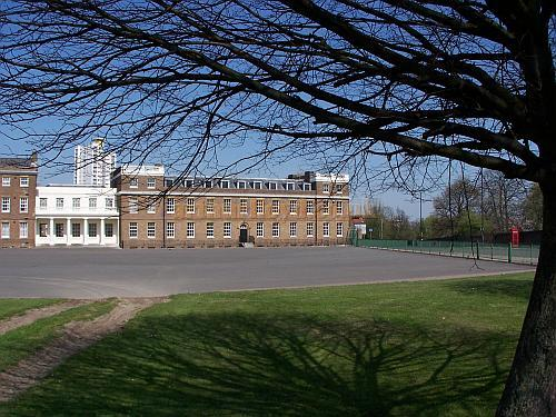 The Royal Artillery Barracks in 2007. The white colonnaded link between the two sections of the building's frontage was originally the site of the Royal Artillery Theatre. The colonnaded link was rebuilt as an exact copy of one which is further west, but out of shot, in the late 1950s and returned the building to its original 1802 appearance. - Photo M.L.07.