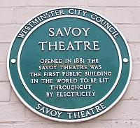 Plaque situated on the side wall of the Savoy Theatre.