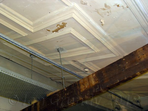Above the stage of the Spa Theatre today, showing the surviving moulded ceiling from before the stage was extended into the auditorium - Courtesy Ian Grundy.