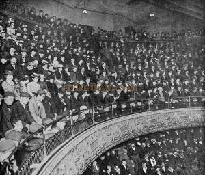"A Typical Music Hall Gallery. The photograph was taken at the ""London"" Music Hall, Shoreditch; the audience, who, at the time, were enjoying a chorus song, were not warned of the fact. - From 'The Playgoer' 1901 - Courtesy Iain Wotherspoon. - Click to Enlarge."