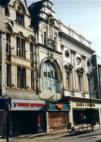 Photograph showing what remains of the Frontage of the Theatre Royal, South Shields (above Marks & Spencer) and the Empire Palace (above Shoefare) in 2004 - Courtesy Gareth Price.
