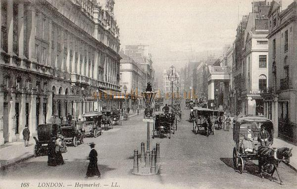 Postcard of the Haymarket, London looking up towards Piccadilly and showing Her Majesty's Theatre on the left and the Theatre Royal, Haymarket on the right.