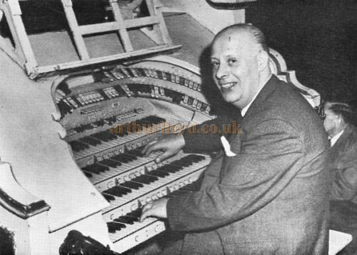 Charles Saxby at the Trocadero, Elephant & Castle in 1956 or 1957 - Photo by Stanley A. Long from the journal of the Cinema Organ Society, June 1970. - Click for the organ's specifications.
