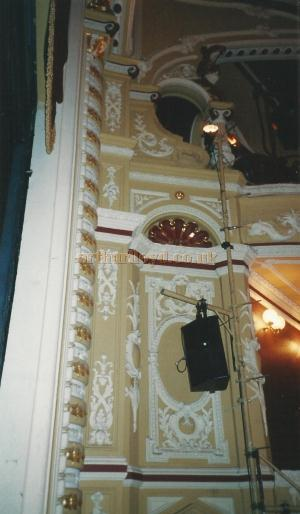 A close up of the proscenium arch plaster work at the Theatre Royal and Opera House, Wakefield in 2000 showing the loss of the original Comedy / Tragedy motifs from the central oval - Courtesy David Garratt.