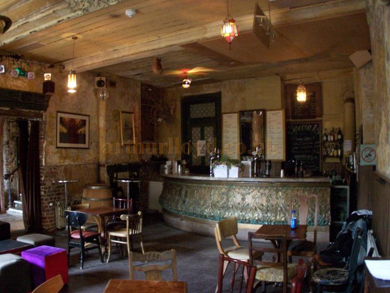 The bar in Wilton's Music Hall in August 2011 -The bar itself is actually part of a set used in the film 'Sherlock Holmes A Game of Shadows' which was partly filmed at Wilton's and generously donated by the production Company. -Photo M.L.