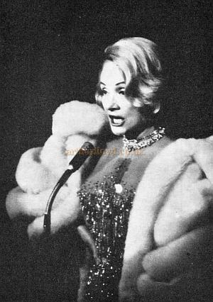 A photograph of Marlene Dietrich performing which was used in both programmes for her 1973 and 1975 performances at the Wimbledon Theatre.