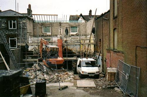 Two shops next door to the Theatre Royal, Winchester being demolished during major refurbishment of the Theatre to make way for new dressing rooms and better FOH facilities in 1999 - Photo Phil Yates, Courtesy Alan Chudley.