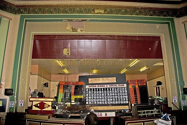 The stage of the 1927 Opera House, Workington whilst in its Bingo guise, note the entrance through the Orchestra Pit to the bar in the basement - Photo Joe Moody - Courtesy Andrew Williamson.